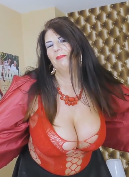 Curvy mature brunette granny with huge tits Lulu teases in bed SOLO