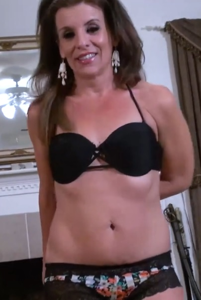 Horny mature American housewife fingering and toying her lusty pussy solo